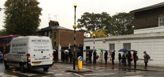 A bus queue. In London. In 2014.